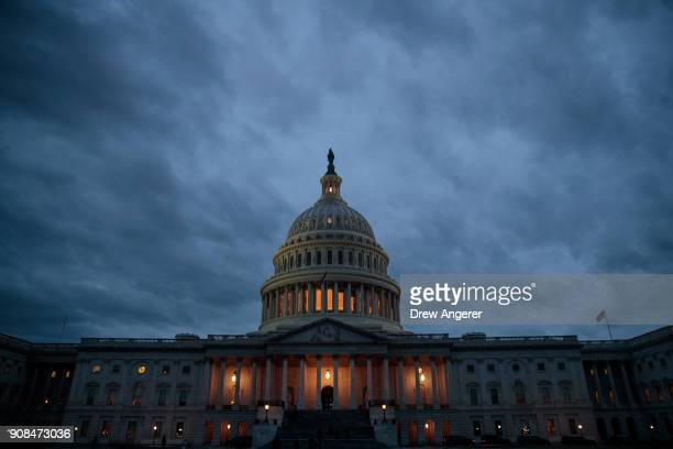 The US Capitol is seen at dusk January 21 2018 in Washington DC Lawmakers are convening for a Sunday session to try to resolve the government shutdown