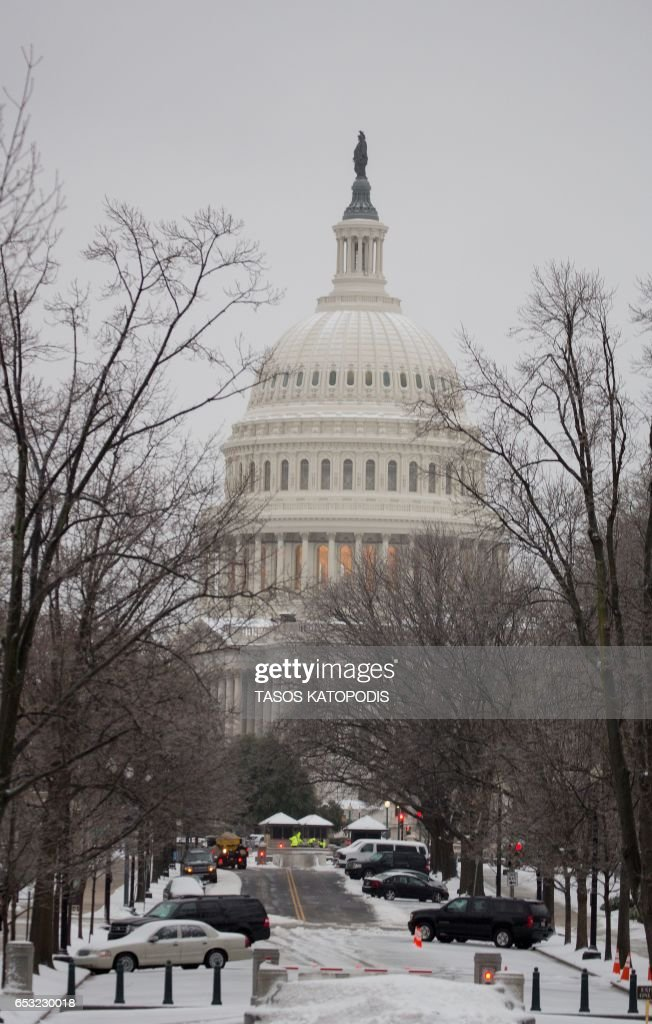 The US Capitol is seen covered in snow in Washington, DC March 14, 2017 Winter Storm Stella dumped snow and sleet Tuesday across the northeastern United States where thousands of flights were canceled and schools closed, but appeared less severe than initially forecast. After daybreak the National Weather Service (NWS) revised down its predicted snow accumulation, saying that the storm had moved across the coast. PHOTO / Tasos Katopodis