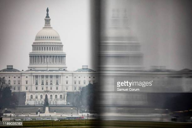 The US Capitol is seen in the distance from the base of the Washington Monument on a stormy morning on December 16 2019 in Washington DC Washington...