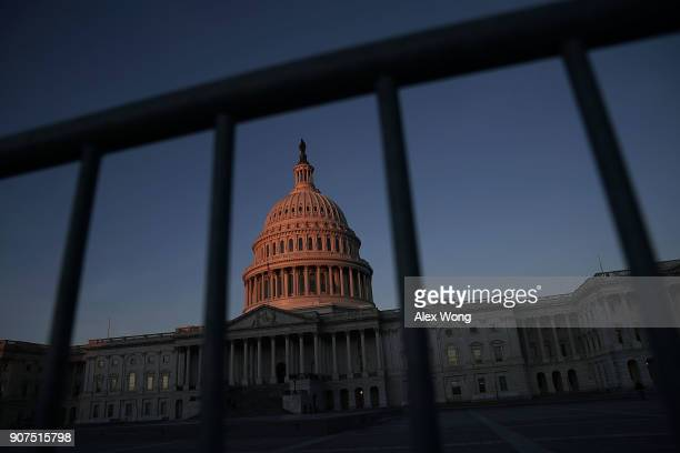 The US Capitol is seen in the morning hours January 20 2018 in Washington DC The US government is being shut down after the Senate failed to pass a...