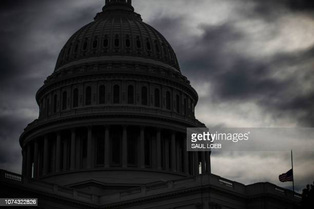 The US Capitol is seen in Washington DC December 17 as the Deadline for lawmakers to agree on a new spending deal to avert shutdown on Dec 22...