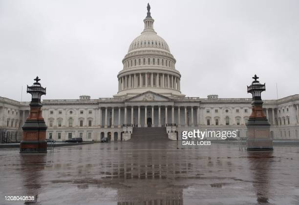 The US Capitol is seen in Washington DC March 23 as the Senate continues negotiations on a relief package in response to the outbreak of COVID19...