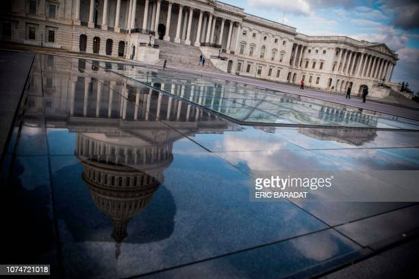 The US Capitol is seen in Washington DC on December 24 2018 US lawmakers headed home for Christmas leaving the government partially shut for a third...