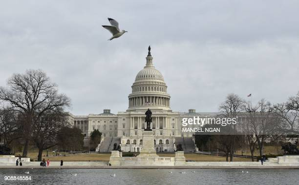 TOPSHOT The US Capitol is seen in Washington DC on January 22 2018 after the US Senate reached a deal to reopen the federal government with Democrats...