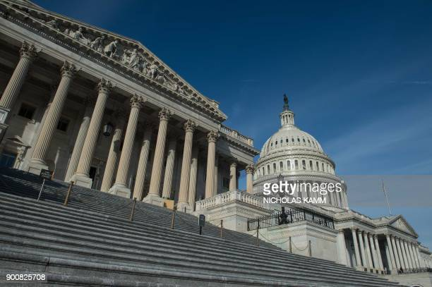 The US Capitol is seen in Washington, DC, on January 3, 2018 before the opening of the second session of the 115th Congress. - The US Congress hits...
