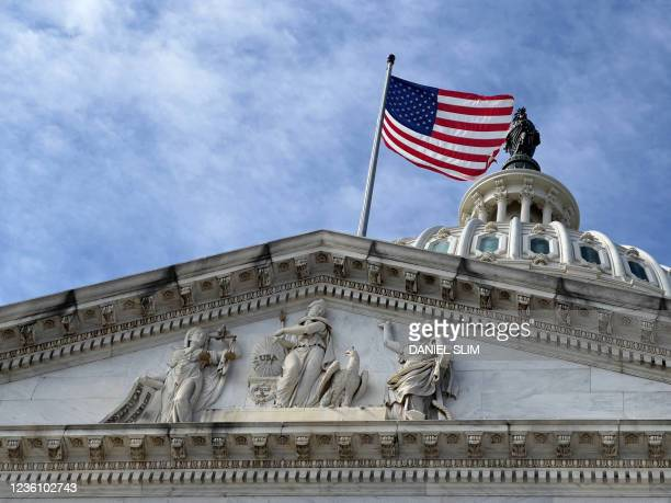 The US Capitol is seen in Washington, DC on October 24, 2021. - After months of fierce political wrangling, House speaker Nancy Pelosi said that she...