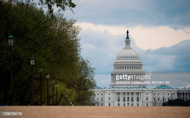 The US Capitol is seen on an empty National Mall in Washington DC on March 31 2020 To prevent the spread of coronavirus COVID19 Virginia Maryland and...
