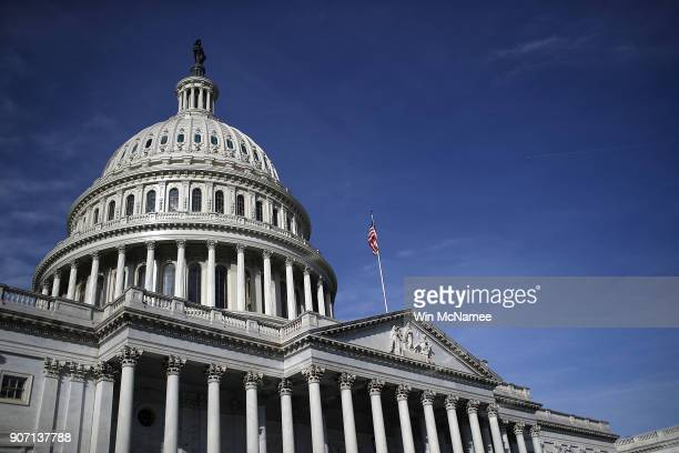 The US Capitol is shown as a looming government shutdown threatens federal government services January 19 2018 in Washington DC Congress continues to...