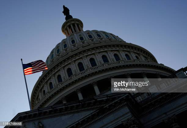 The U.S. Capitol is shown late December 18, 2019 in Washington, DC. Later this evening the U.S. House of Representatives is expected to vote on two...