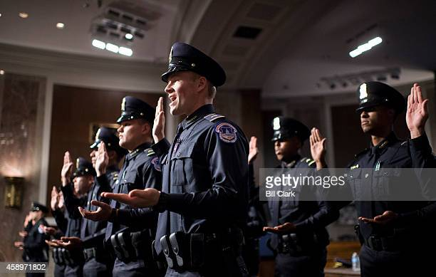 The US Capitol Police Recruit Officer Class 177 is sworn in during a ceremony in the Dirksen Senate Office Building on Friday Nov 14 2014