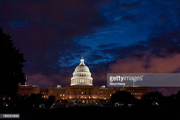The US Capitol stands at sunrise in Washington DC US on Thursday Oct 17 2013 The passage last night by wide margins an 8118 vote in the Democraticled...