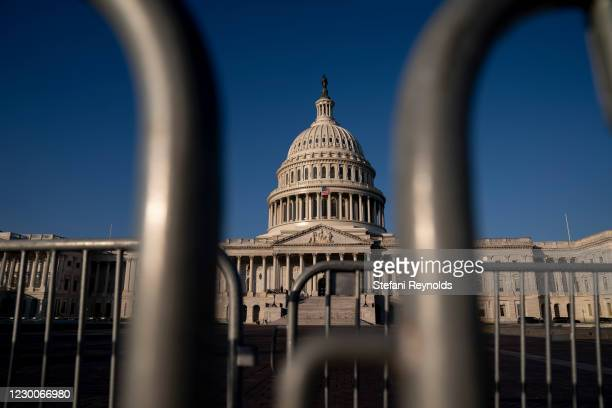 The U.S. Capitol stands behind police barricades on December 11, 2020 in Washington, DC. Lawmakers are facing a midnight deadline to pass a...