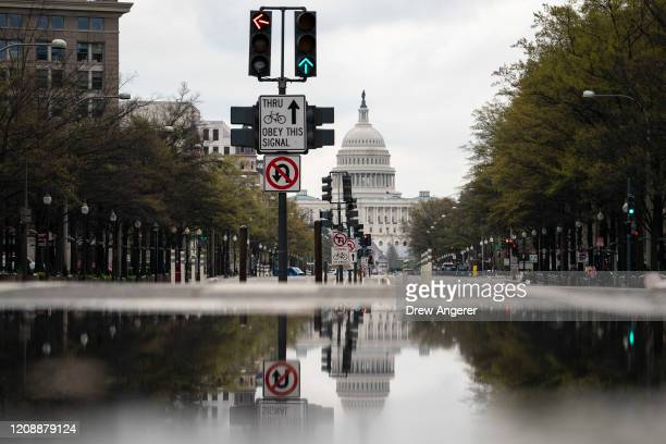 The US Capitol stands in the background as Pennsylvania Avenue is mostly empty on Wednesday morning April 1 2020 in Washington DC As of April 1 the...