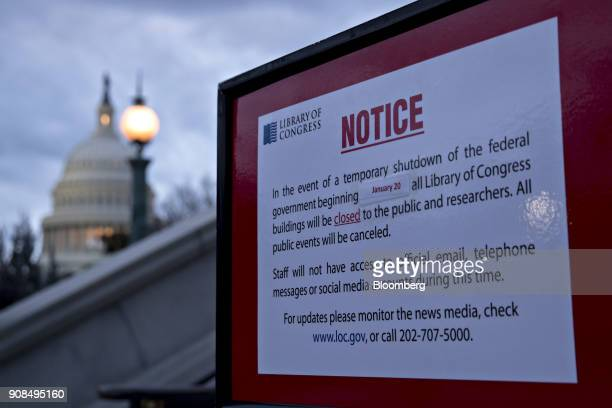 The US Capitol stands past a temporary shutdown sign outside the Library of Congress in Washington DC US on Sunday Jan 21 2018 The House and Senate...
