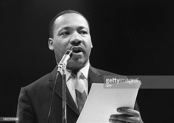 The US clergyman and civil rights leader Martin Luther King addresses 29 March 1966 in Paris' Sport Palace the militants of the Movement for the...