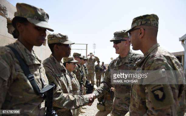 The US commander in Afghanistan John Nicholson shakes hands with US soldiers ahead of a handover ceremony at Leatherneck Camp in Lashkar Gah in the...