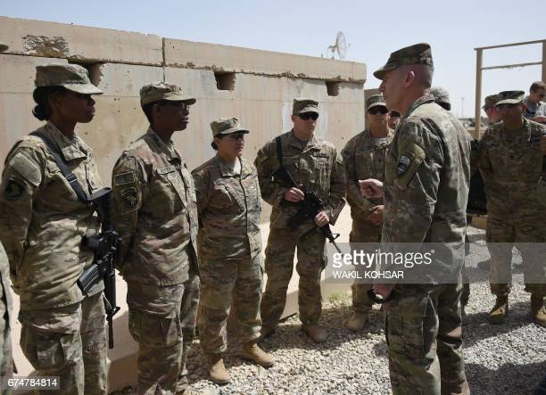 The US commander in Afghanistan John Nicholson talks with soldiers ahead of a handover ceremony at Leatherneck Camp in Lashkar Gah in the Afghan...