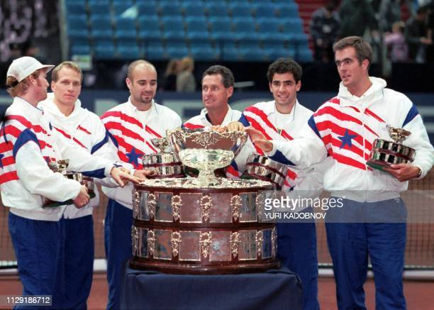 The US Davis Cup Team poses for photographers after winning the Davis Cup final against Russia in Moscow 03 December 1995 From left to right Jim...