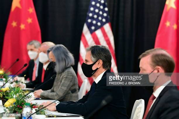 The US delegation led by Secretary of State Antony Blinken , flanked by US National Security Advisor Jake Sullivan , face their Chinese counterparts...