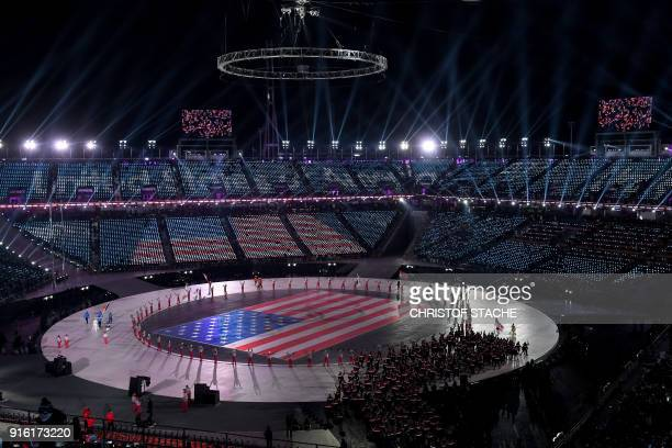 The US delegation parades during the opening ceremony of the Pyeongchang 2018 Winter Olympic Games at the Pyeongchang Stadium on February 9 2018 /...