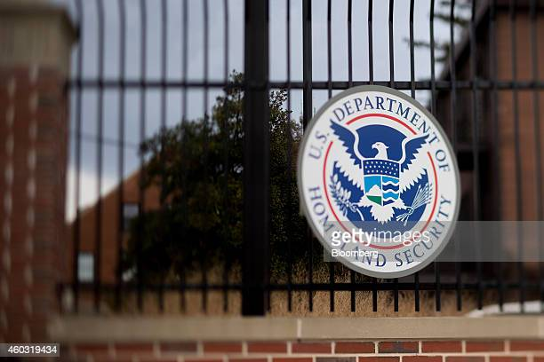 The US Department of Homeland Security seal hangs on a fence at the agency's headquarters in this photo taken with a tiltshift lens in Washington DC...