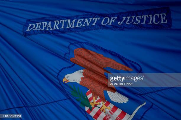The US Department of Justice flag is seen in Washington DC on July 22 2019