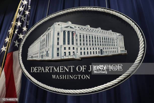The US Department of Justice seal is displayed following a news conference with Rod Rosenstein deputy attorney general not pictured in Washington DC...