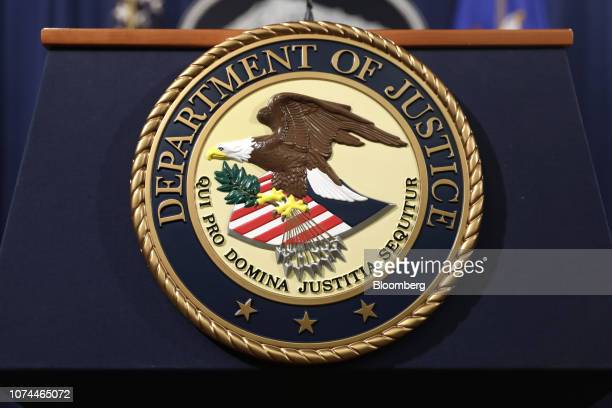 The US Department of Justice seal is displayed on a podium following a news conference with Rod Rosenstein deputy attorney general not pictured in...
