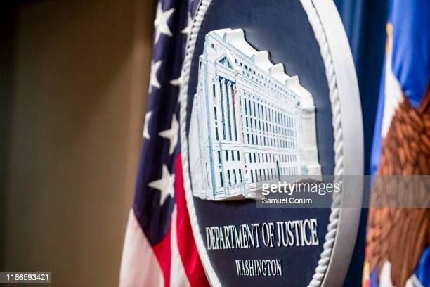 The U.S. Department of Justice seal on the stage where U.S. And U.K. Law enforcement officials will announce warrants for the arrests of Maksim...