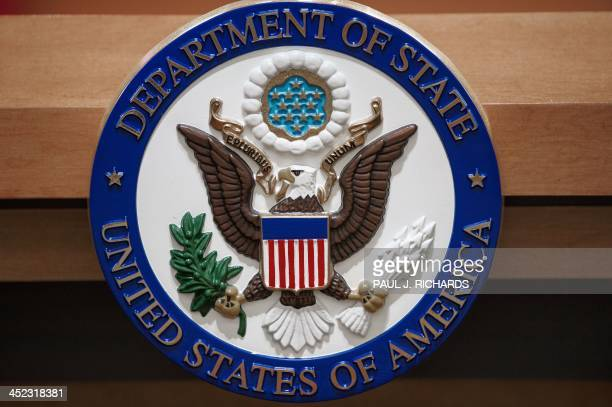 The US Department of State seal is seen on the podiumlectern area November 26 2013 in the State Department briefing room in Washington DC AFP...
