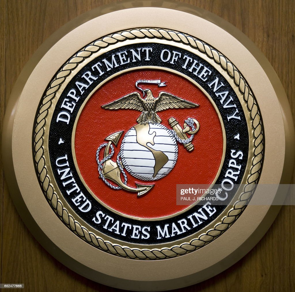 The Us Department Of The Navy Us Marine Corps Seal Hangs On The