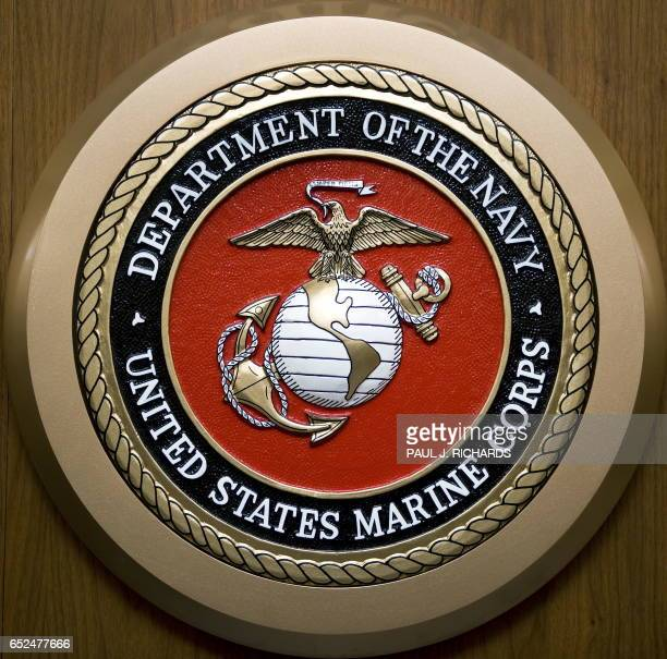 The US Department of the Navy US Marine Corps seal hangs on the wall February 24 at the Pentagon in WashingtonDC AFP Photo/Paul J Richards / AFP...