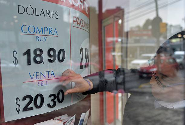 The Us Dollar Exchange Rate Is Seen On Board Of A Bank In Mexico City