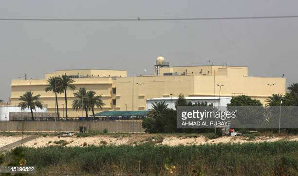 The US embassy compound is pictured in Baghdad's Green Zone on May 20, 2019 in the Iraqi capital. - A Katyusha rocket crashed the previous day into...