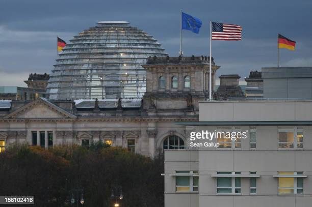 The US Embassy stands near the Reichstag seat of the Bundestag on October 28 2013 in Berlin Germany The embassy is becoming a focus in the current...