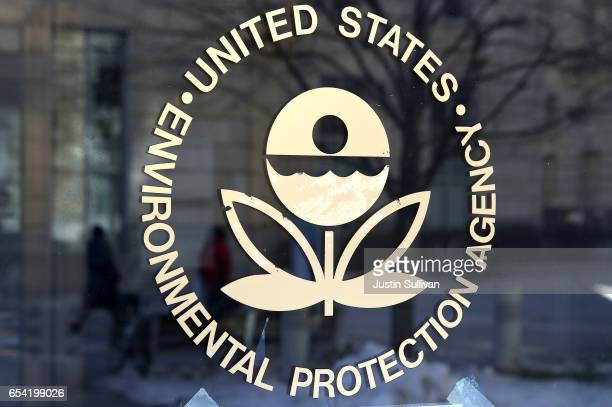 The US Environmental Protection Agency's logo is displayed on a door at its headquarters on March 16 2017 in Washington DC US President Donald...