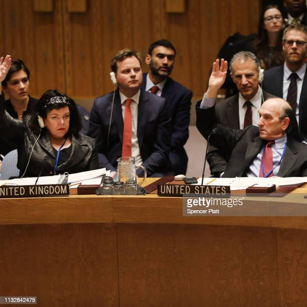 The US envoy on Venezuela Elliott Abrams and UK ambassador to the United Nations Karen Pierce vote at the United Nations Security Council in favor of...