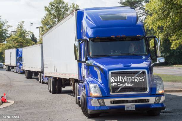 The US Federal Highway Administration conducts demonstrations of partially automated semitruck platoons September 14 with three specially equiped...