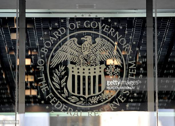 The US Federal Reserve emblem is seen on August 08 2011 in Washington DC after Standard Poor's cut the US rating from its topflight tripleA one notch...