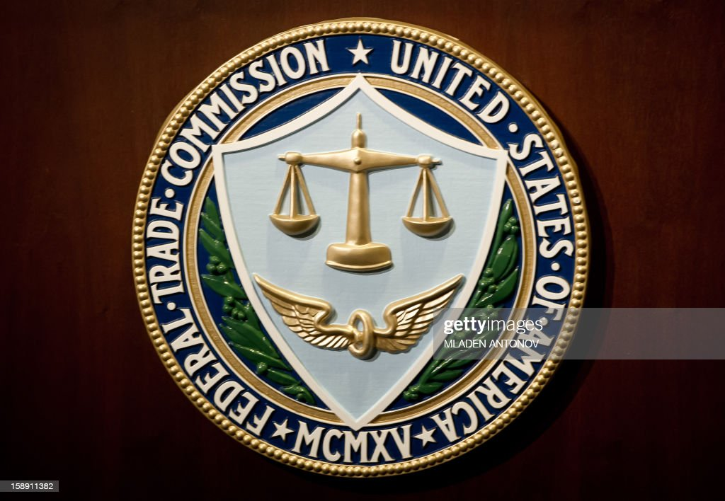 The US Federal Trade Commission seal is seen during a press conference in Washington, DC on January 3, 2013.