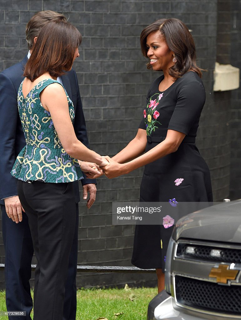 The US First Lady Michelle Obama (R) is greeted by Samantha Cameron (L) during her visit of 10 Downing Street on June 16, 2015 in London, England.