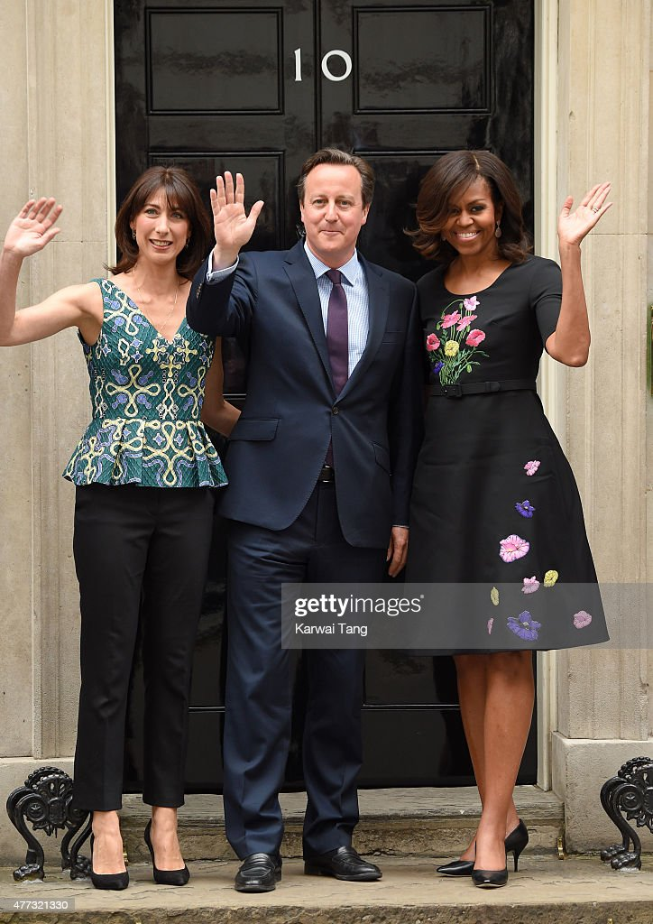 The US First Lady Michelle Obama (R) poses with Samantha (L) and David Cameron (C) during her visit of 10 Downing Street on June 16, 2015 in London, England.