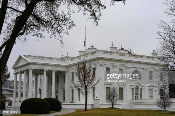 The US flag flies at half mast for the victims of the Atlanta shooting in Washington, DC, on March 18, 2021. - A 21-year-old suspect described as a...