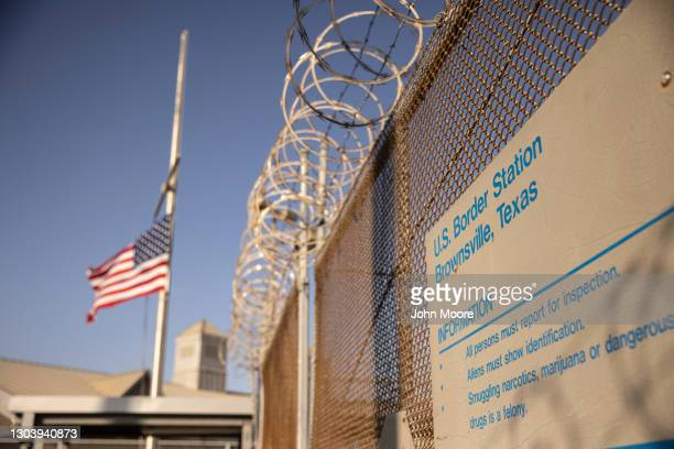 The U.S. Flag flies at half staff at a port of entry at the U.S.-Mexico border on February 24, 2021 in Brownsville, Texas. U.S. President Joe Biden...