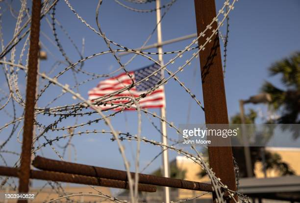 The U.S. Flag flies at half staff at the port of entry at the U.S.-Mexico border on February 24, 2021 in Brownsville, Texas. U.S. President Joe Biden...