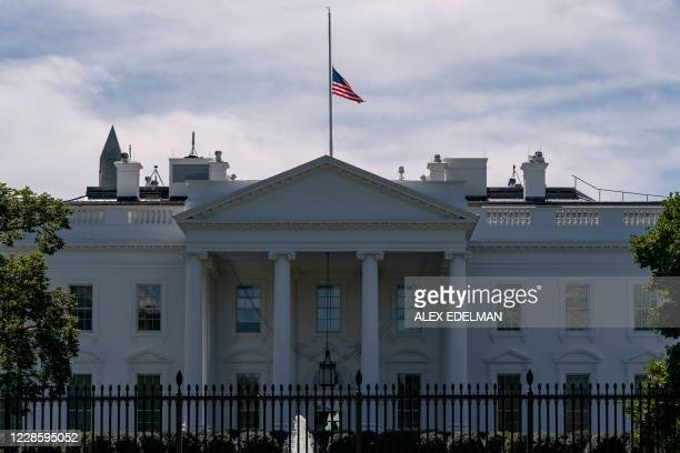 The US flag flies at half-mast above the White House in Washington, DC, on September 19, 2020 after the passing of US Supreme Court Justice Ruth...