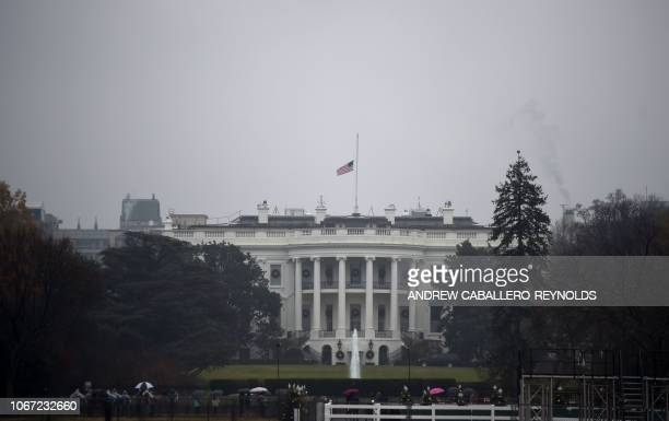 The US flag flies at halfstaff at the White House in tribute to former US President George H W Bush on December 1 in Washington DC Bush who guided...