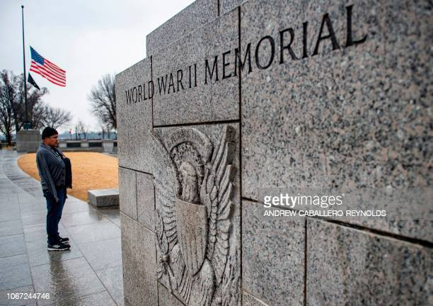 The US flag flies at halfstaff at the World War II Memorial in tribute to former US President George H W Bush on December 1 in Washington DC Bush who...