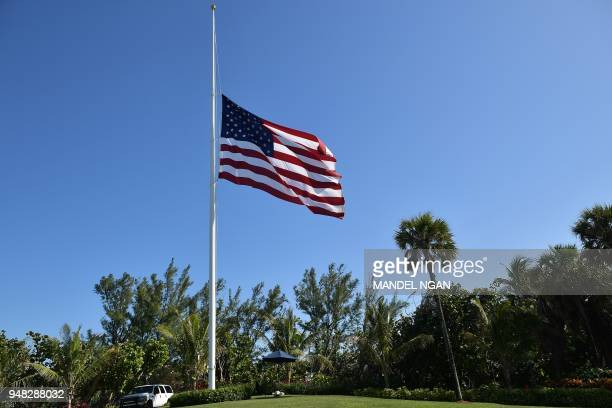 The US flag flies at half-staff at US President Donald Trump's Mar-a-Lago resort in Palm Beach, Florida on April 18, 2018. Trump ordered flags to fly...