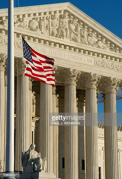 The US flag flies at half-staff outside the US Supreme Court on January 9 in memory of the victims of the January 8 shootings in Tucson, Arizona,...